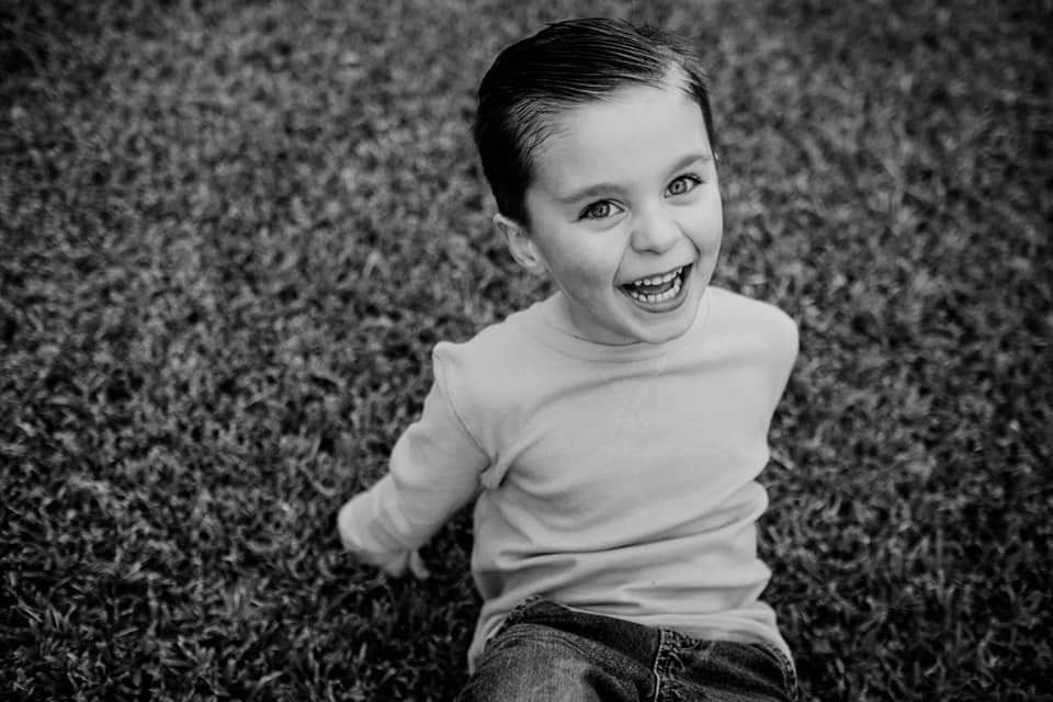 black and white picture of young boy laughing