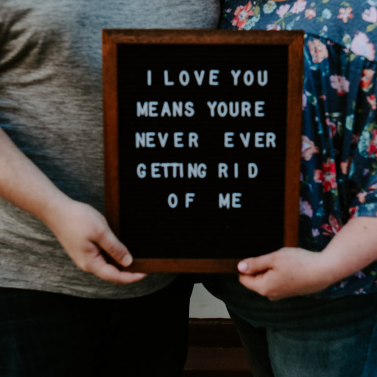 "black letter board reads "" I love you means you're never ever getting rid of me"""